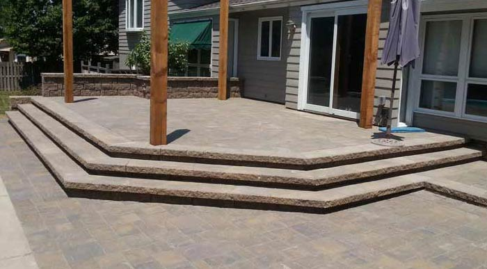 Custom Paved Patio | Stone Capped Wall with Stone Stairs