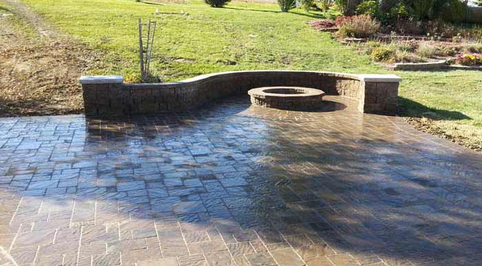 Firepit | Paved Patio with Curved Stone Capped Wall | Omaha Nebraska