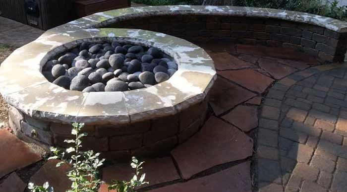 Stone Capped Firepit | Backyard Paved Patio with Curved Wall