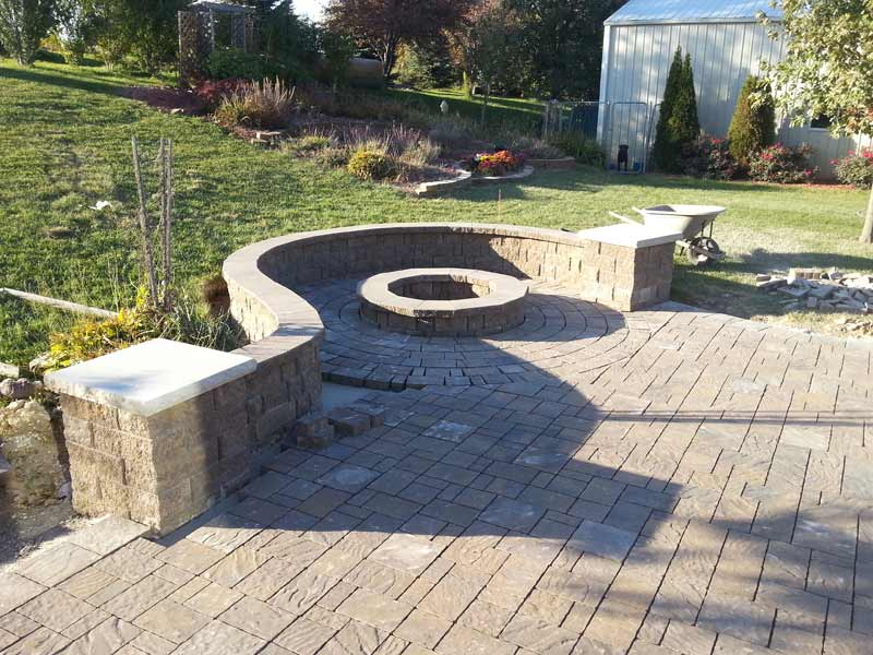 Firepit With Curved Retaining Wall Stoned Paved Patio