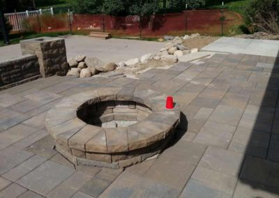 firepit-with-stone-paved-patio-and-capped-stone-wall-2