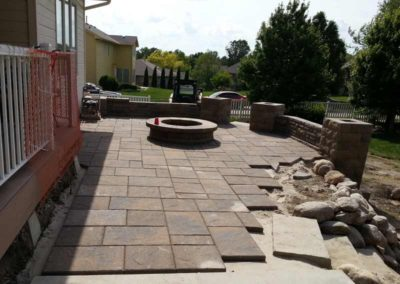 firepit-with-stone-paved-patio-and-capped-stone-wall-3
