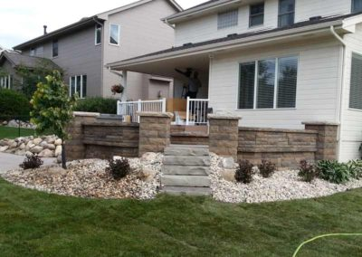 firepit-with-stone-paved-patio-and-capped-stone-wall-6