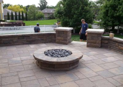 firepit-with-stone-paved-patio-and-capped-stone-wall-9
