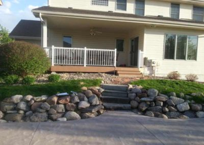firepit-with-stone-paved-patio-and-capped-stone-wall-before-1