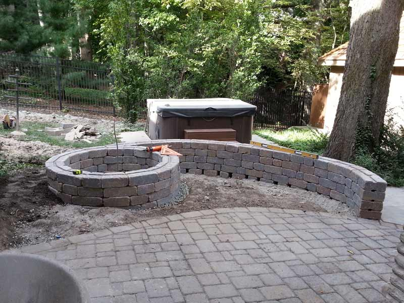 Stone Capped Firepit Paved Backyard Patio 001